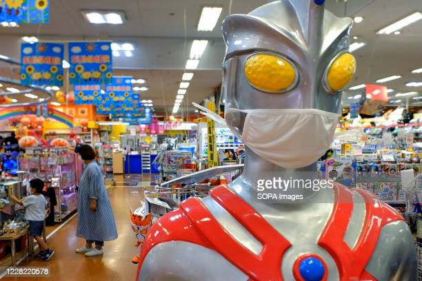 Ultraman, the hero of justice, wears a facemask to call attention to the customers to wear facemasks as a preventive measure against Coronavirus ....