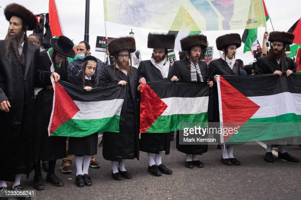 Ultra-Orthodox anti-Zionist Haredi Jews from Neturei Karta UK stand holding Palestinian flags during the National Demonstration for Palestine on 22nd...