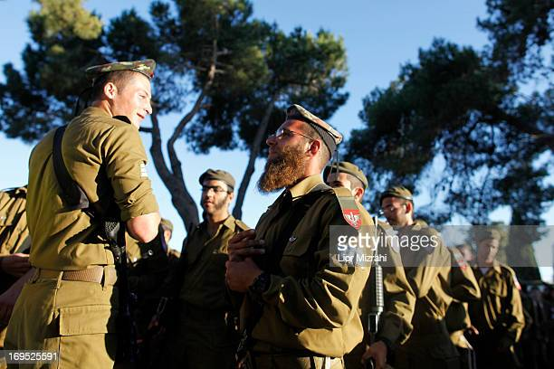 UltraOrthodox Israelis gather prior to a military graduation ceremony on May 26 2013 in Jerusalem Israel The Netzah Yehuda battalion was formed in...
