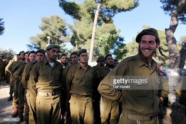 Ultra-Orthodox Israelis gather prior to a military graduation ceremony on May 26, 2013 in Jerusalem, Israel. The Netzah Yehuda battalion was formed...