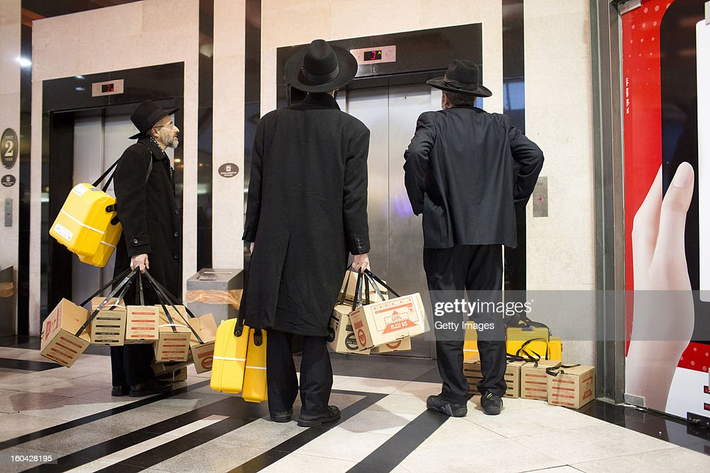 Ultra-Orthodox Israelis wait for an elevator after they collected gas mask kits from a distribution station in a mall January 31, 2013, in Pisgat Ze'ev, East Jerusalem, Israel. Israel remains on high alert after the Israeli air force reportedly launched an airstrike January 30, on a convoy that Israeli officials said was carrying weapons from Syria to Lebanon on the Syria-Lebanon border.