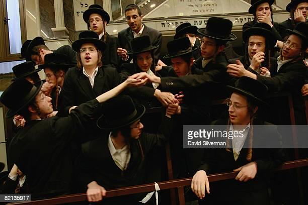 UltraOrthodox Jewish boys scramble for lucky charms which were hidden under monthold infant Yehoshua Rosenboim during his the Redemption Of The First...