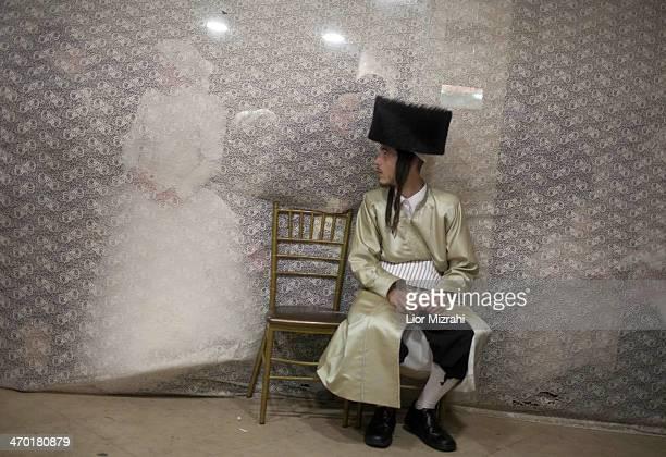 UltraOrthodox Jewish bride Rebecca Hanna and her groom Aharon Cruise are seen during their wedding in the Mea Shearim neighborhood on February 18...