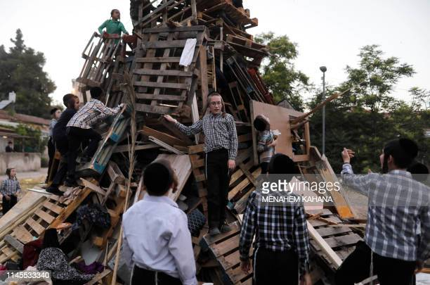UltraOrthodox Jewish children built a bonfire to be lit in the evening in Jerusalem's ultraOrthodox Mea Shearim neighborhood on May 22 to celebrate...