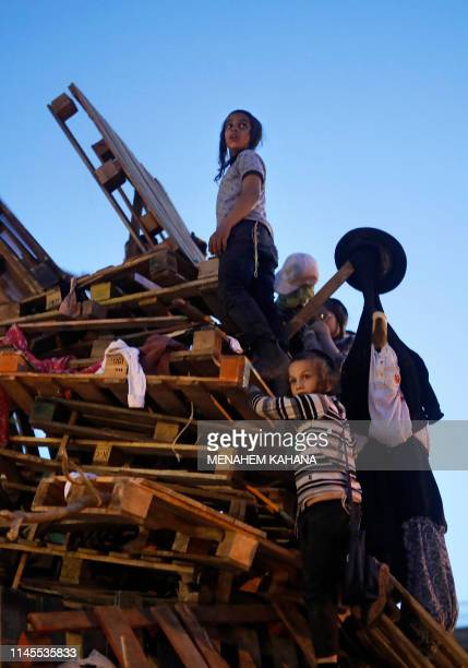 UltraOrthodox Jewish children built a bonfire to be lit in the evening in Jerusalem's ultraOrthodox Mea Shearim neighborhood on May 22 to celebrate...