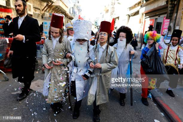 UltraOrthodox Jewish children dressed in costumes participate in a school parade celebrating Purim two days ahead of the official holiday in the Mea...