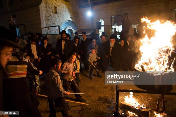 UltraOrthodox Jewish children play next to a bonfire at Lag BaOmer celebration on May 2 2018 in Jerusalem Israel The Lag BaOmer bonfire is lit to...