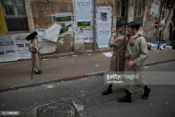 UltraOrthodox Jewish children wearing costumes are seen in the Mea Shearim ultraOrthodox neighbourhood on March 25 2016 in Jerusalem Israel The...