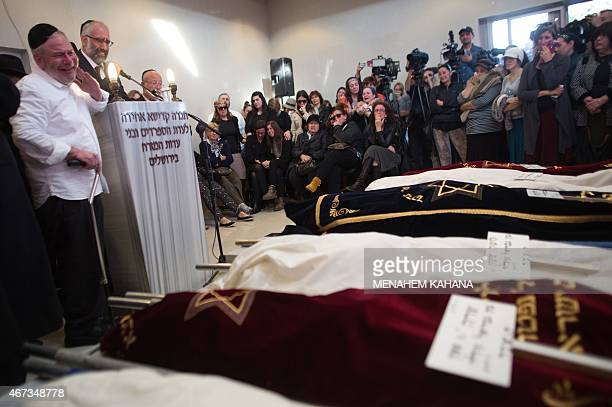 Ultraorthodox Jewish father Gabriel Sassoon cries during the funeral of seven of his children at the Givat Shaul cemetery in Jerusalem on March 23...