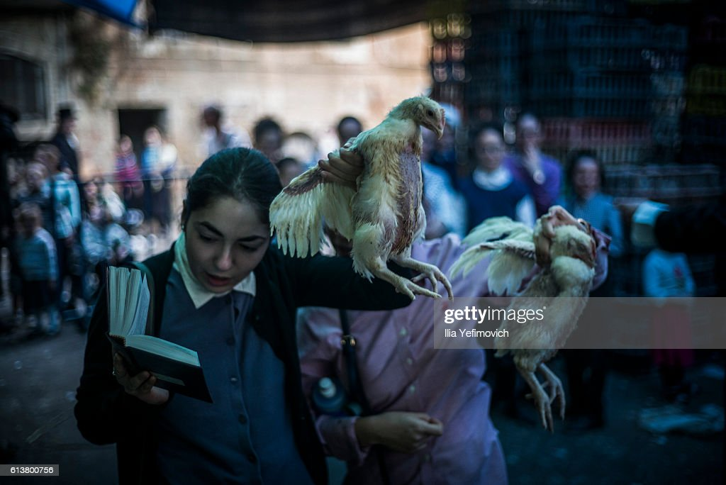 Ultra-Orthodox Jewish girls perform the Kaparot ceremony on October 10, 2016 in Jerusalem, Israel. It is believed that the Jewish ritual, which involves swinging a live chicken above one's head, transfers the sins of the past year to the chicken, which is then slaughtered and traditionally given to the poor. It is performed before the Day of Atonement, or Yom Kippur, the most important day in the Jewish calendar, which this year will start at sunset on October 11.