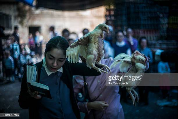 UltraOrthodox Jewish girls perform the Kaparot ceremony on October 10 2016 in Jerusalem Israel It is believed that the Jewish ritual which involves...