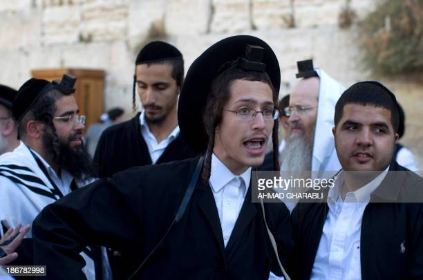 A UltraOrthodox Jewish man shout during a protest against members of the liberal Jewish religious group 'Women of the Wall' who are wearing...