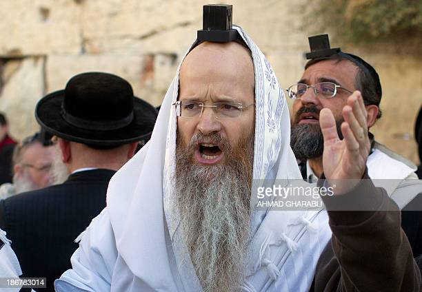 A UltraOrthodox Jewish man shouts during a protest against members of the liberal Jewish religious group Women of the Wall who are wearing...