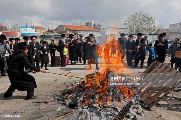 UltraOrthodox Jewish men burn leavened items during the Biur Chametz ritual on April 19 2019 in Jerusalem on the eve of the Jewish Pesach holiday...