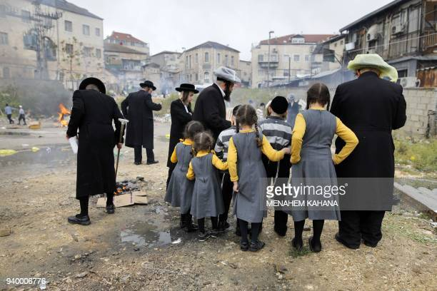 UltraOrthodox Jewish men burn leavened items during the Srefat Chametz ritual on March 30 2018 in Jerusalem on the eve of the Jewish Pesach holiday...