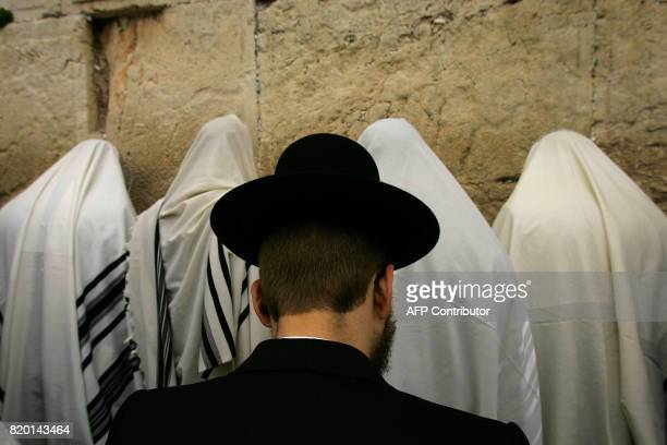 UltraOrthodox Jewish men cover their heads with Talit prayer shawls as they recite the Cohanim blessing at the Western Wall in the Old City of...
