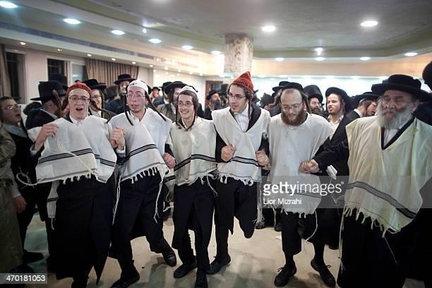 UltraOrthodox Jewish men dance during the wedding of Rebecca Hanna and her groom Aharon Cruise in the Mea Shearim neighborhood on February 18 2014 in...
