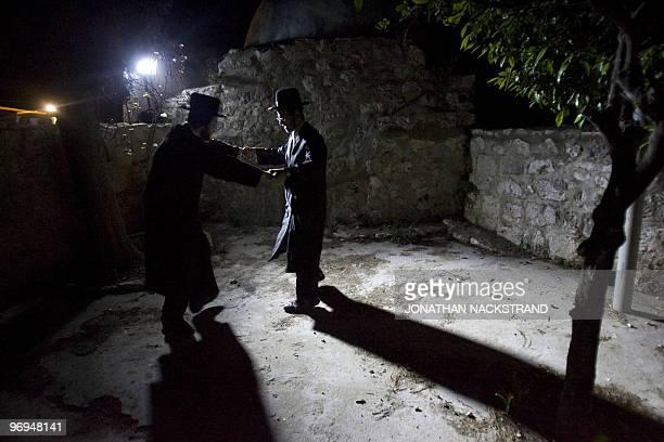 UltraOrthodox Jewish men dance near the tomb of Jewish biblical figure Calev ben Yefuneh in the northern Palestinian village of Kifl Hareth in the...