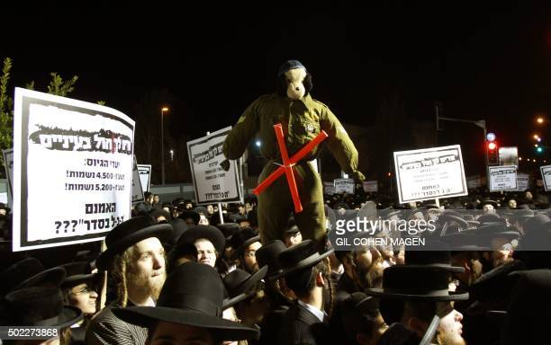 UltraOrthodox Jewish men hold placards against military service during a protest against any plans to end the exemption of the ultraOrthodox young...