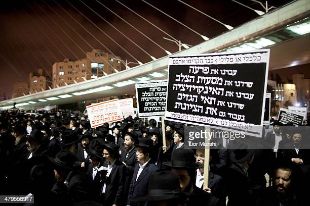 UltraOrthodox Jewish men hold placards during a demonstration on March 19 2014 in Jerusalem Israel All over Israel ultraOrthodox people protested...