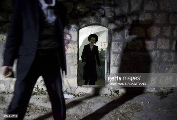 UltraOrthodox Jewish men leave after praying at the tomb of Jewish biblical figure Calev ben Yefuneh in the northern Palestinian village of Kifl...