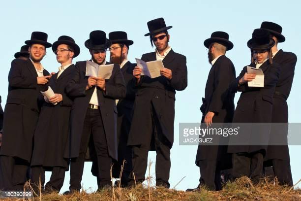 UltraOrthodox Jewish men pray along the Ayarkon River in the city of Ramat Gan near Tel Aviv during the ritual of 'Tashlich' on September 12 2013...