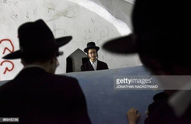 UltraOrthodox Jewish men pray at the tomb of Jewish biblical figure Calev ben Yefuneh in the northern Palestinian village of Kifl Hareth in the West...