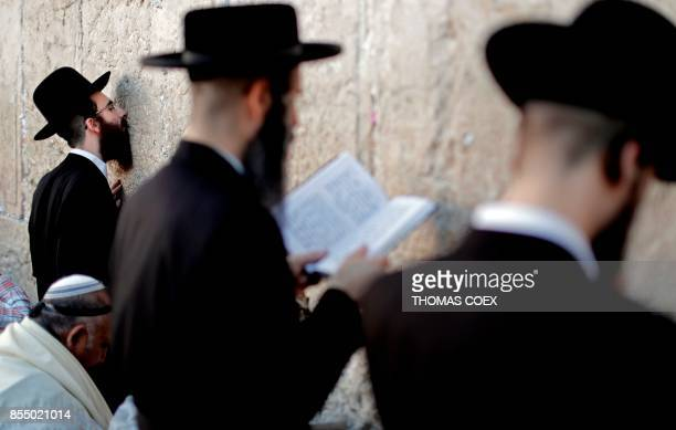 UltraOrthodox Jewish men pray at the Western Wall in the Old City of Jerusalem on the eve of Yom Kippur also known as the Day of Atonement the...