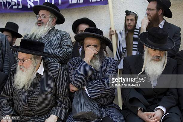 UltraOrthodox Jewish men pray during a protest against any plans to make them undergo military service on August 31 2014 in Jerusalem Last year the...