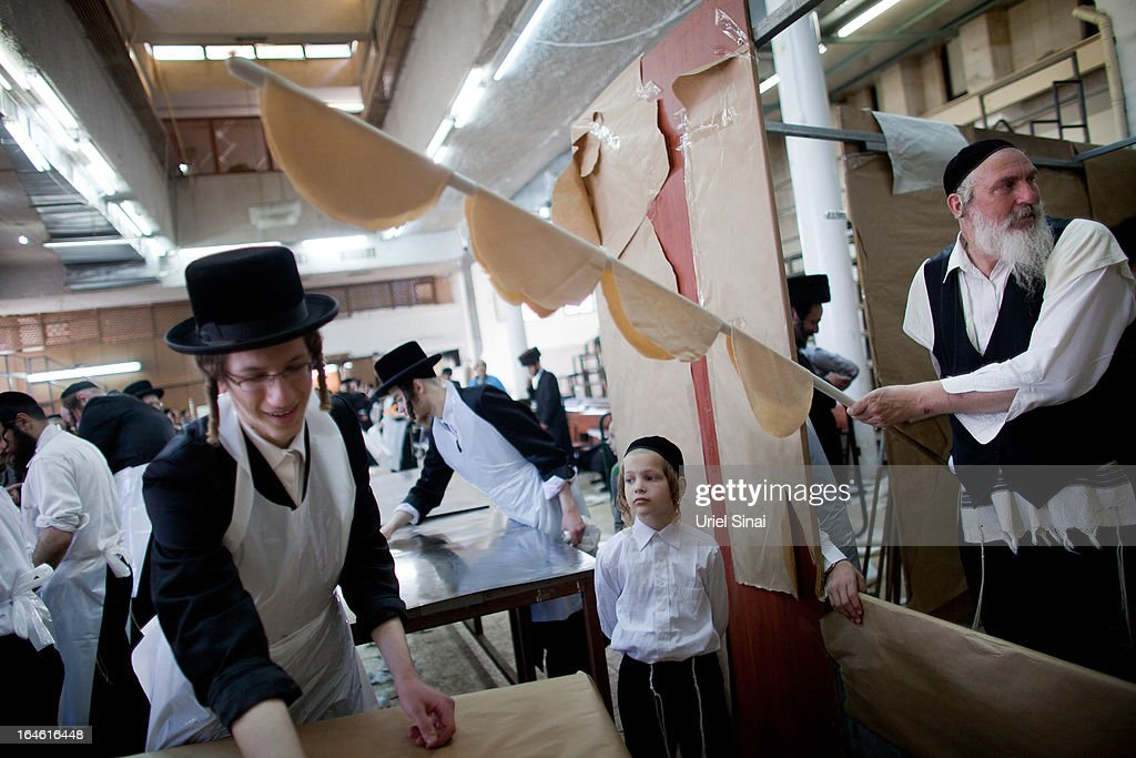 Ultra-Orthodox Jewish men prepare Matzoth, or unleavened bread, in a final preparation before the start at sundown of the Jewish Pesach (Passover) holiday on March 25, 2013 in Bnei Brak, Israel. Religious Jews throughout the world eat matzoth during the eight-day Passover, or Pesach, holiday, The Jewish holiday commemorates the Israelis' exodus from Egypt some 3,500 years ago and their ancestors' plight by refraining from eating leavened food. Passover begins March 25 and ends on the evening of April 02. (Photo by Uriel Sinai/Getty Images