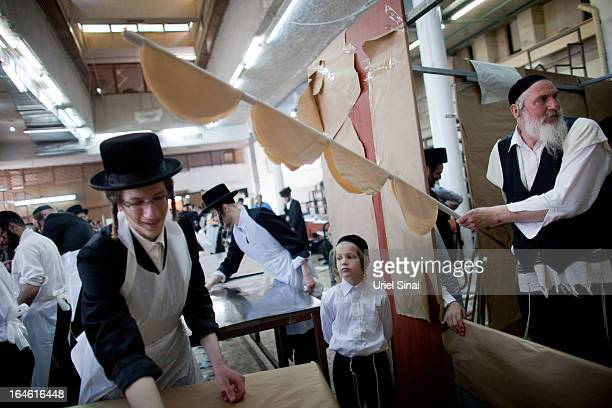 UltraOrthodox Jewish men prepare Matzoth or unleavened bread in a final preparation before the start at sundown of the Jewish Pesach holiday on March...