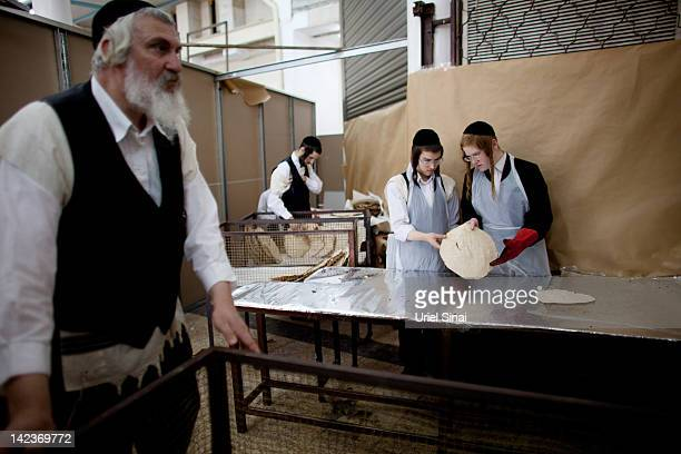 UltraOrthodox Jewish men prepare the Matzoth or unleavened bread on April 3 2012 in Bnei Brak Israel Religious Jews throughout the world eat matzoth...