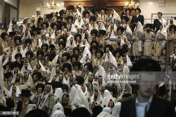 TOPSHOT UltraOrthodox Jewish men read the book of Esther in their synagogue in Jerusalem's Mea Shearim ultraOrthodox neighbourhood on March 13 2017...