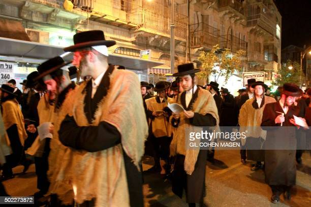 UltraOrthodox Jewish men take part in a protest against any plans to end the exemption of the ultraOrthodox young men studying at seminaries from...