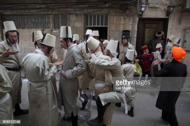 UltraOrthodox Jewish men wearing costumes are seen in the Mea Shearim ultraOrthodox neighbourhood on March 2 2018 in Jerusalem Israel The...