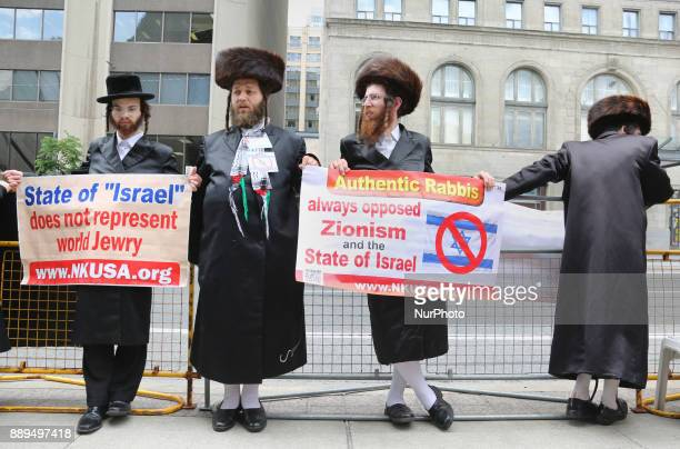 UltraOrthodox Jewish Rabbis hold signs denouncing Israel during a demonstration in Toronto Canada on July 29 2017 Muslims and Jews came together to...