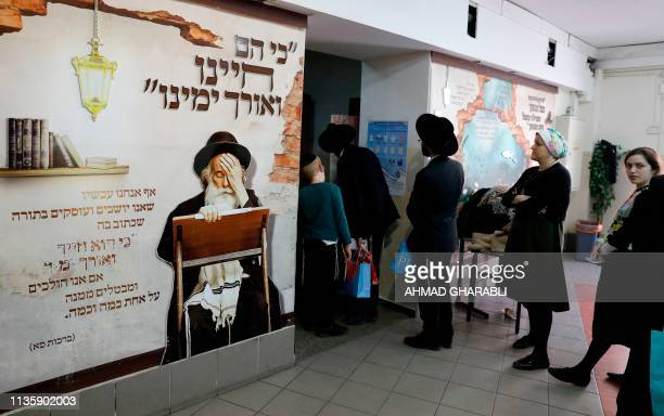 UltraOrthodox Jewish voters queue to cast their vote during Israel's parliamentary elections on April 9 2019 in the central Israeli city of Bnei Brak...