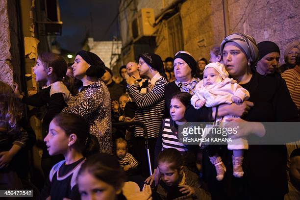 UltraOrthodox Jewish women and children attend an inauguration ceremony for a new Torah scrolls at a religious neighborhood in Jerusalem on October 1...