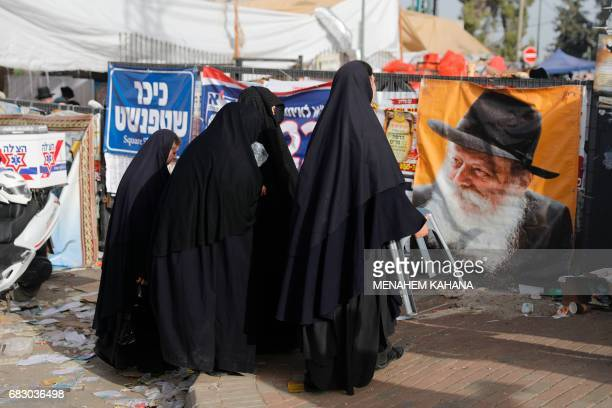 UltraOrthodox Jewish women known in Israel as Neshot Ha Shalim who cover themselves completely in a burqalike headtotoe black cloth attend the...