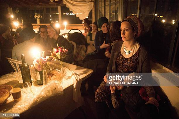 TOPSHOT Ultraorthodox Jewish women share a candle light diner to celebrate the Jewish ritual of Sheva Brachot also known as the wedding blessings on...