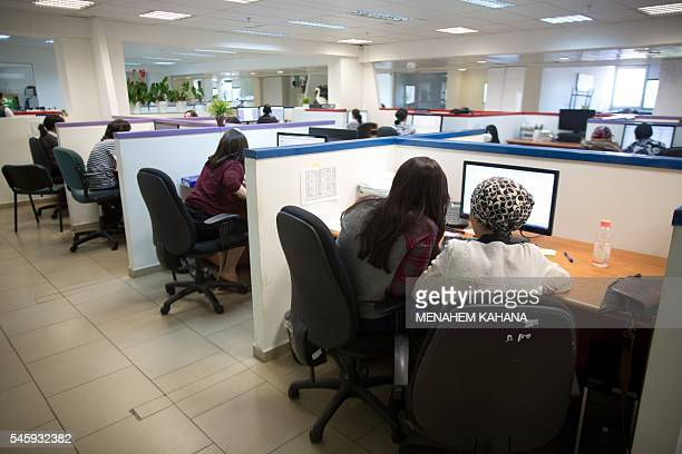 UltraOrthodox Jewish women work on computers at their desks in the Comax software company office in the central city of Holon near Tel Aviv on April...