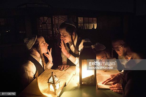 TOPSHOT Ultraorthodox Jewish youths read Judaism's holy books during a diner to celebrate the Jewish ritual of Sheva Brachot also known as the...