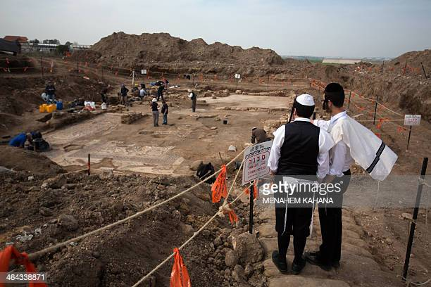 UltraOrthodox Jewish youths watch as Israeli archaeologists excavate a 1500yearold floor mosaic depicting the resurrection of Jesus Christ in a...