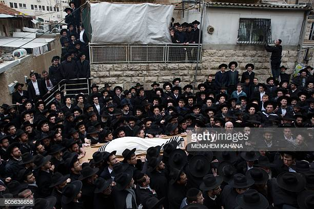 Ultraorthodox Jews carry the body of Rabbi Refoel Shmulevitz wrapped in a prayer shawl during his funeral outside the Mir Yeshiva religious school in...