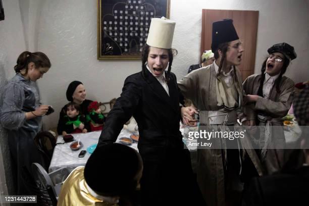 Ultra-Orthodox jews celebrate the Jewish holiday of Purim in their house in the Ultra-Orthodox neighborhood of Mea Shearim on February 28, 2021 in...