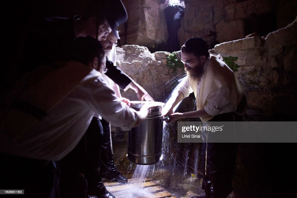 Ultra-Orthodox Jews collect water from a mountain spring to be used to bake the matzoth (unleavened bread) during the Maim Shelanu ceremony on March 14, 2013 in Jerusalem, Israel. Religious Jews throughout the world eat matzoth during the eight-day Passover, or Pesach, holiday, The Jewish holiday commemorates the Israelis' exodus from Egypt some 3,500 years ago and their ancestors' plight by refraining from eating leavened food. Passover begins March 25 and ends on the evening of April 02.