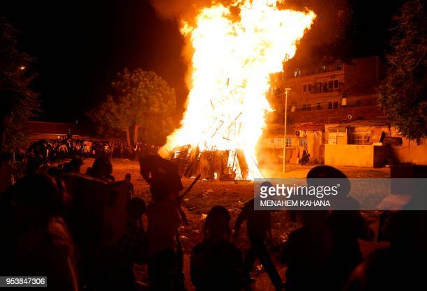 UltraOrthodox Jews gather before a bonfire in Jerusalem's ultraOrthodox Mea Shearim neighbourhood on May 2 during celebrations for the Jewish holiday...