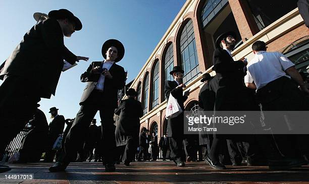 UltraOrthodox Jews gather before entering Citi Field for a meeting to discuss the risks of using the Internet on May 20 2012 in the Queens borough of...