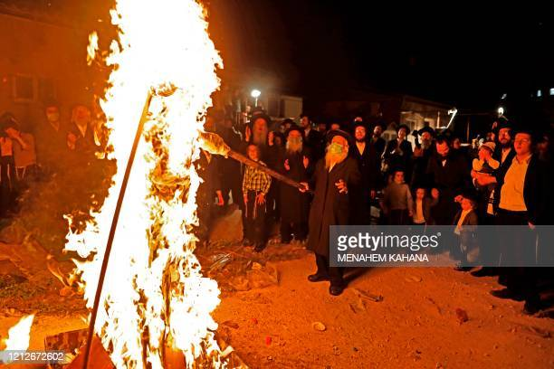 UltraOrthodox Jews light a Lag BaOmer bonfire in Jerusalem's religious Mea Shearim neighbourhood amid an Israeli health ministry's order to maintain...