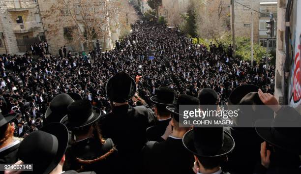TOPSHOT UltraOrthodox Jews mourn during the funeral of Rabbi Shmuel Auerbach a radical Israeli rabbi who led opposition to attempts to force...